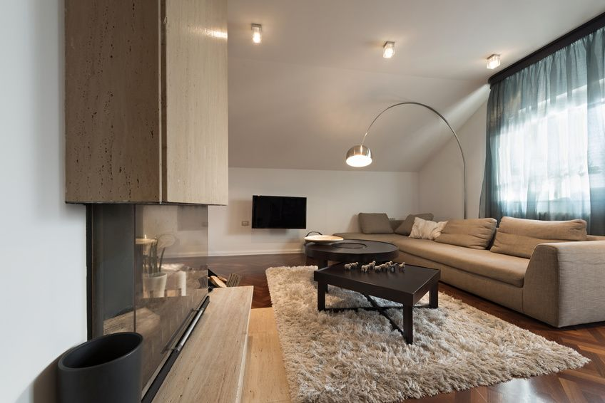 Interior of loft apartment - living room with fireplace